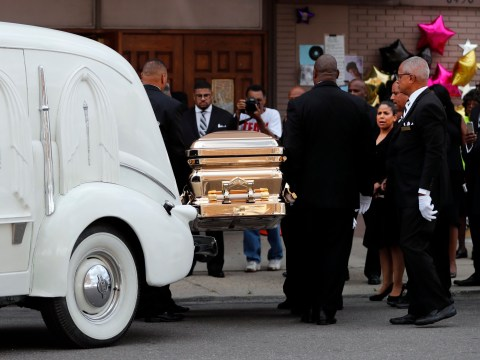 Aretha Franklin given costume change as gold casket is moved to father's former church where she began singing
