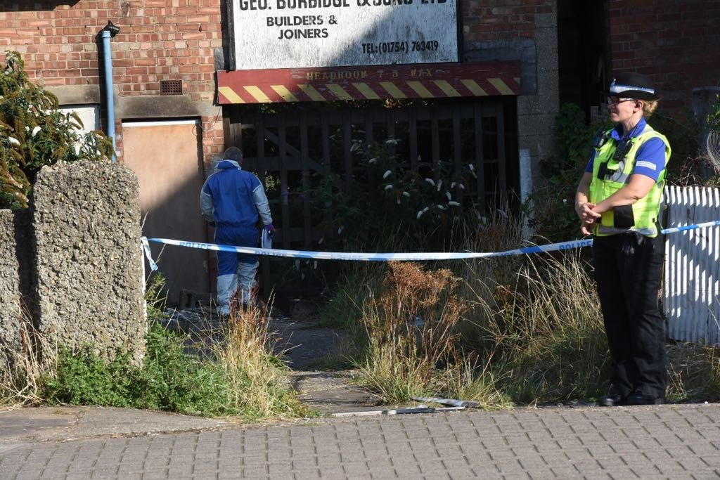 Body of woman in her 40s found near garage in Lincolnshire