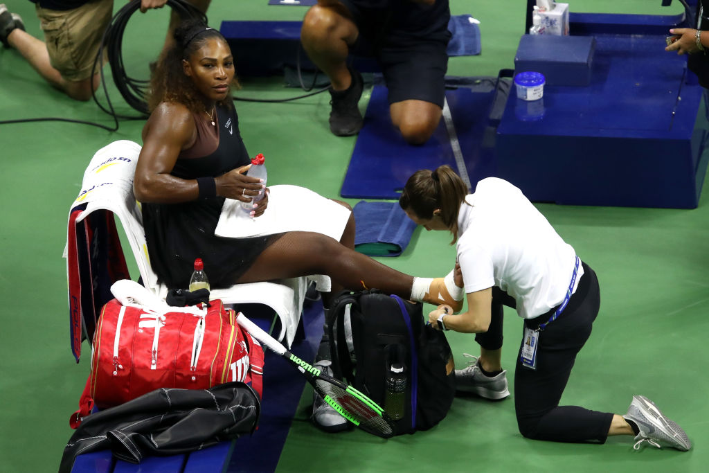Serena Williams survives injury scare to demolish sister Venus in 30th meeting