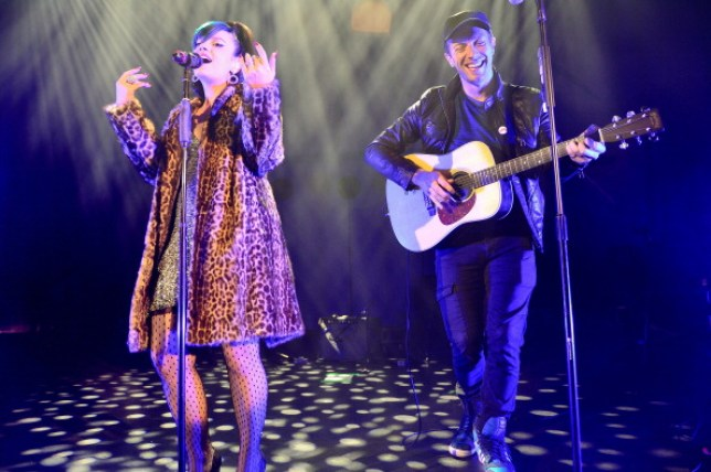 Lily Allen and Chris Martin performing