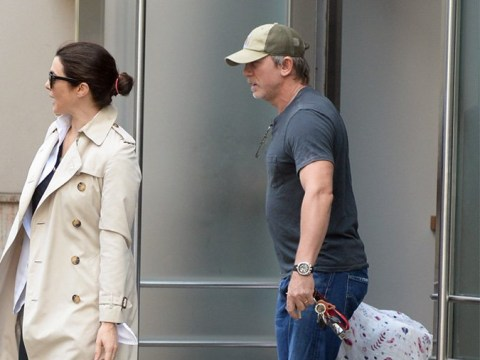 Dad, new Dad: Daniel Craig takes on daddy duty as he is pictured with baby daughter for first time