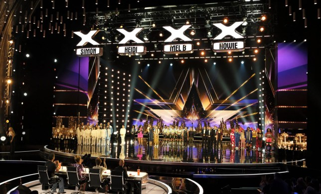 "AMERICA'S GOT TALENT -- ""Live Quarter Finals Results 1"" Episode 1312 -- Pictured: (l-r) Simon Cowell, Heidi Klum, Mel B, Howie Mandel; (On Stage) Angel City Chorale, Mochi, Amanda Mena, Vicki Barbolak, We Three, Courtney Hadwin, Junior New System, Lord Nil, Human Fountains, Shin Lim, The PAC Dance Team, Flau'jae -- (Photo by: Justin Lubin/NBC/NBCU Photo Bank via Getty Images)"