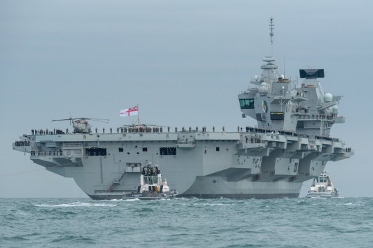 HMS Queen Elizabeth leaving Portsmouth's Naval Base 18/08/18. The Royal Navy's aircraft carrier HMS Queen Elizabeth has set sail for the US where it will land fighter jets on its flight deck for the first time. Large crowds watched the ??3billion warship leave Portsmouth Naval Base for its maiden voyage on Saturday, eight years since a fast jet last flew from a British aircraft carrier. Naval chiefs have pledged that the 65,000-tonne carrier, nicknamed Big Lizzie, will have the protection needed against the 'eye-watering' threat from Russia and other powers around the world.