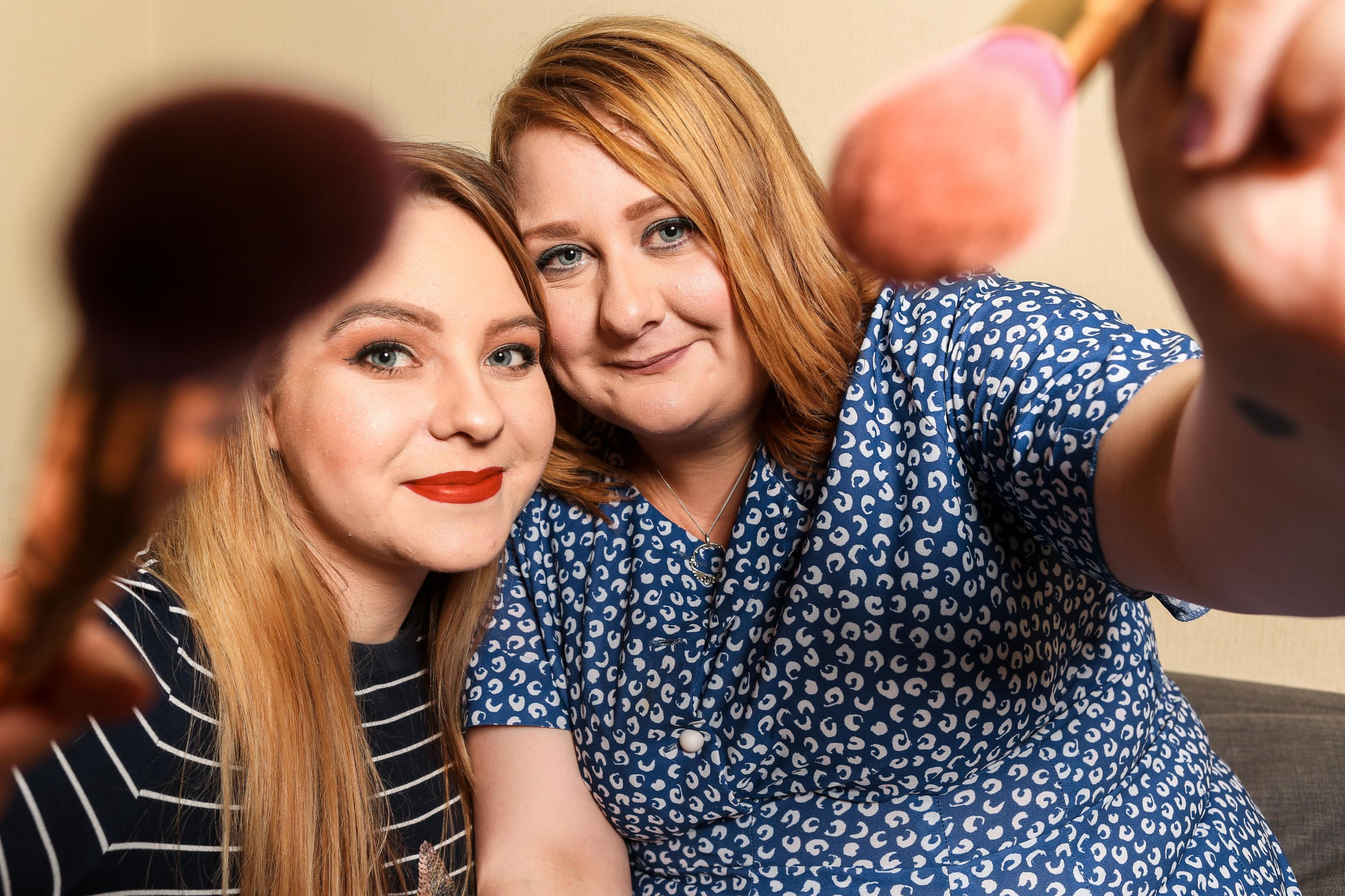 Pics by James Ward/Caters News - (Pictured: Laura Greaves (Blue Dress) and Alex Lucas. Selly Oak, Birmingham. 28/08/2018) - Two blind women have become best friends and now create makeup tutorials together after both losing their sight overnight with no explanation. Laura Greeves, now 26, started losing her sight aged just 24 when in just a matter of days she began to see black spots and her vision became blurred.Doctors were unable to explain the sudden deterioration of her eyesight, which left her unable to work and drive, and she was forced to bring forward her wedding to husband, David, after fears she wouldnt be able to see him on her big day. Laura met 25-year-old Alex Lucas at a support group after learning she had also lost her sight overnight at just 23-years-old and was also left without a reason for her loss of sight. The pair have now gone on to inspire others with make-up and cooking YouTube tutorials and even run a weekly podcast to help other blind and partially sighted people, called suddenly sightless. Mum-of-one Laura, a former administrator from Selly Oak, Birmingham, said: I had to accept that I was never going to know why I had lost my sight and also my independence. SEE CATERS COPY.