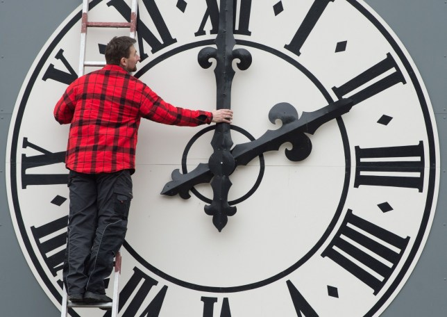 Picture taken on March 23, 2018 shows a technician working on the clock of the Lukaskirche Church in Dresden, eastern Germany. - The European Commission will recommend EU member states abolish daylight saving, where clocks are advanced by one hour in summer, its president Jean-Claude Juncker said on German television on August 31, 2018. (Photo by Sebastian Kahnert / dpa / AFP) / Germany OUTSEBASTIAN KAHNERT/AFP/Getty Images