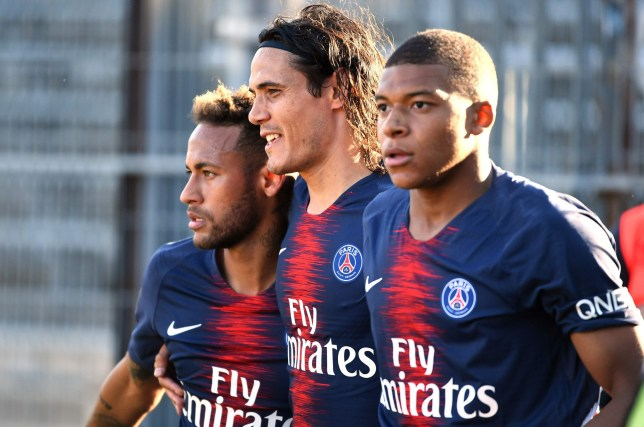 Paris Saint-Germain's French forward Kylian Mbappe (R) celebrates with Paris Saint-Germain's Uruguayan forward Edinson Cavani (C) and Paris Saint-Germain's Brazilian forward Neymar Jr (L) after scoring their third goal during the French L1 football match between Nimes and Paris Saint-Germain (PSG), on September 1, 2018 at the Costieres stadium in Nimes, southern France. (Photo by PASCAL GUYOT / AFP)PASCAL GUYOT/AFP/Getty Images