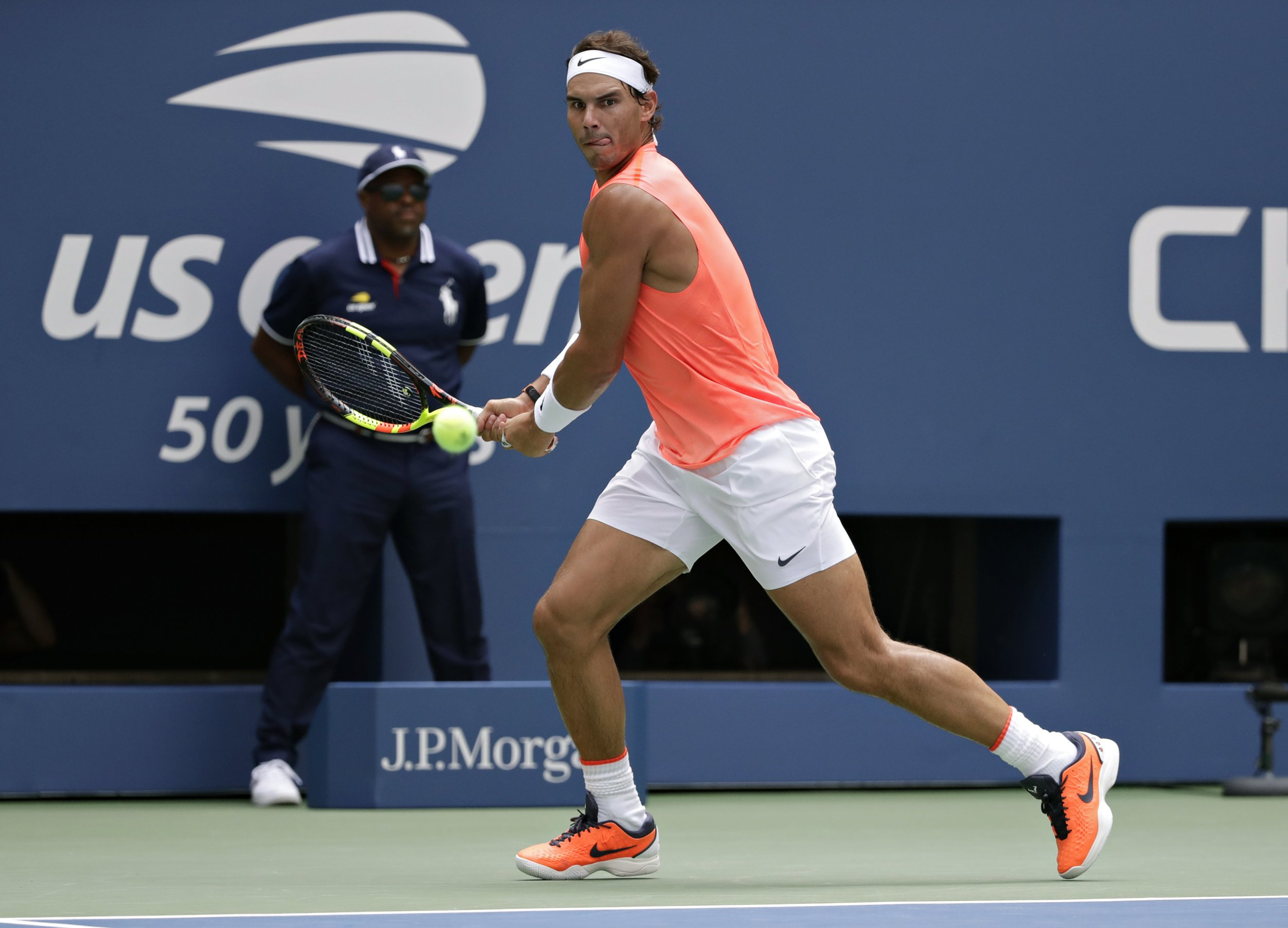 Rafael Nadal, of Spain, chases down a shot from Nikoloz Basilashvili, of Georgia, during the fourth round of the U.S. Open tennis tournament, Sunday, Sept. 2, 2018, in New York. (AP Photo/Carolyn Kaster)