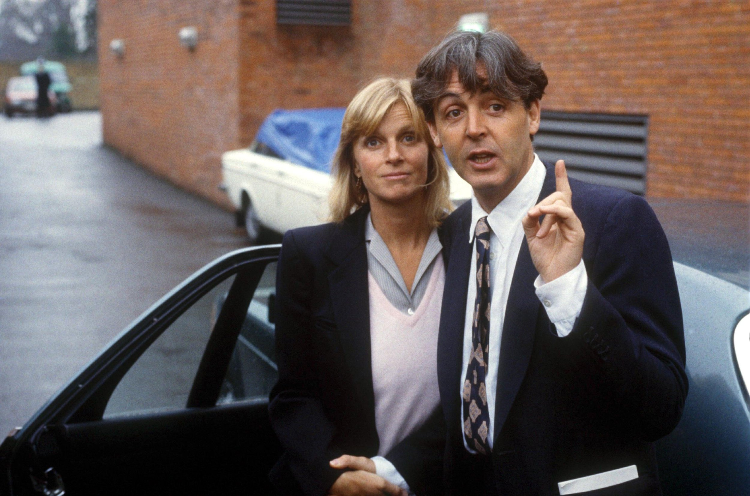 British singer-songwriter Paul McCartney and his wife, Linda, at Middlesex Magistrates Court, Uxbridge, after they appeared on charges of customs evasion of cannabis at Heathrow Airport on their return from Barbados, 24th January 1984. The couple were fined seventy-five pounds after pleading guilty. (Photo by Bryn Colton/Getty Images)