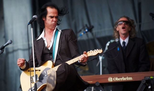 GLASTONBURY, UNITED KINGDOM - JUNE 28: Nick Cave and Conway Savage of Nick Cave and the Bad Seeds performs on stage on the last day of Glastonbury Festival at Worthy Farm on June 28, 2009 in Glastonbury, England. (Photo by Gary Wolstenholme/Redferns)