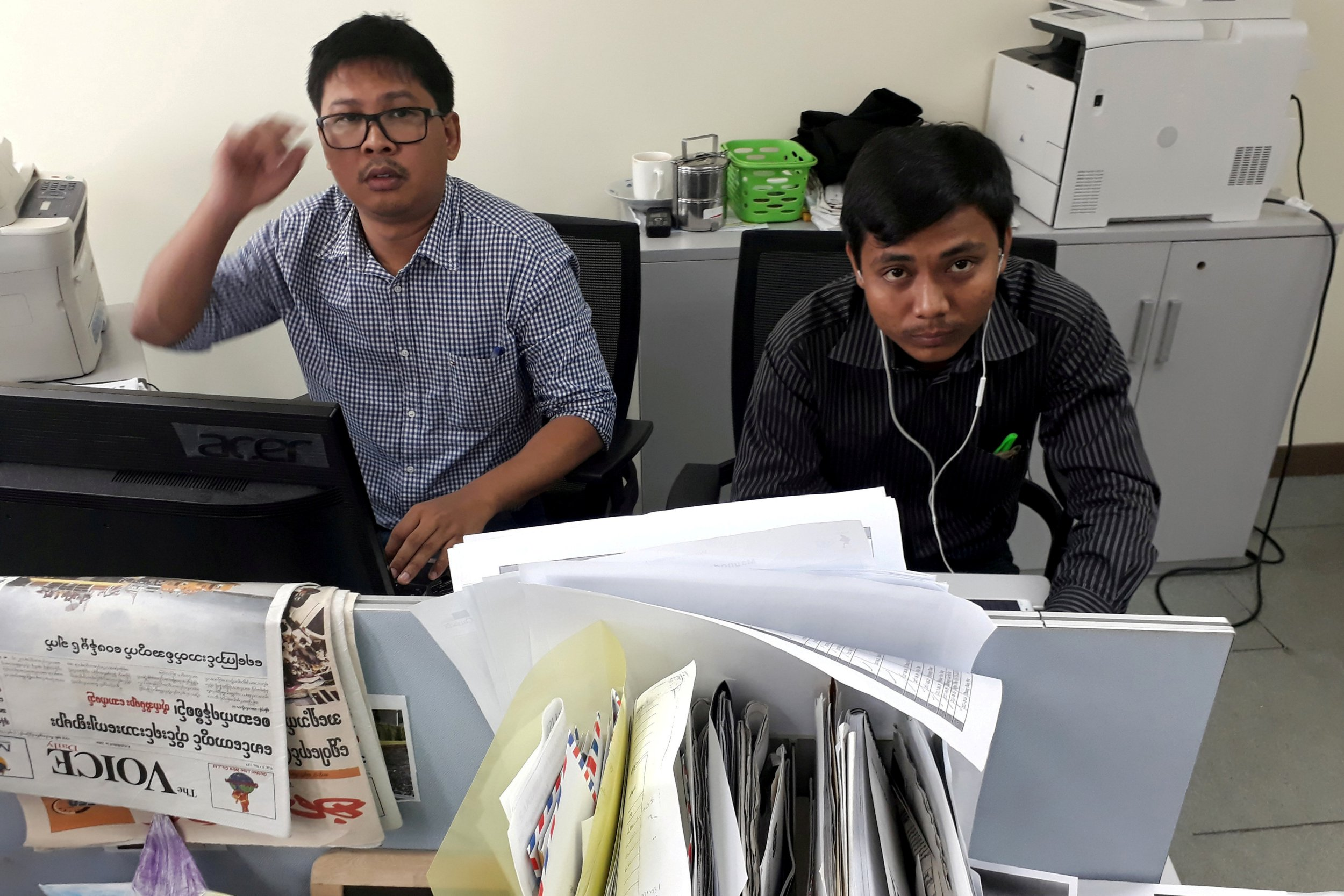 FILE PHOTO: Reuters journalists Wa Lone (L) and Kyaw Soe Oo, who are based in Myanmar, pose for a picture at the Reuters office in Yangon, Myanmar December 11, 2017. To match Special Report MYANMAR-JOURNALISTS/TRIAL REUTERS/Antoni Slodkowski/File Photo