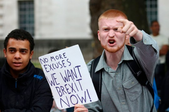 A man carrying an anti-EU pro-Brexit placard shouts in a counter protest against pro-Europe marchers on a March for Europe demonstration against the Brexit vote in Parliament Square in central London on September 3, 2016. Thousands marched in central London to Parliament Square in a pro-Europe rally against the referendum vote to leave the European Union. / AFP PHOTO / JUSTIN TALLIS (Photo credit should read JUSTIN TALLIS/AFP/Getty Images)