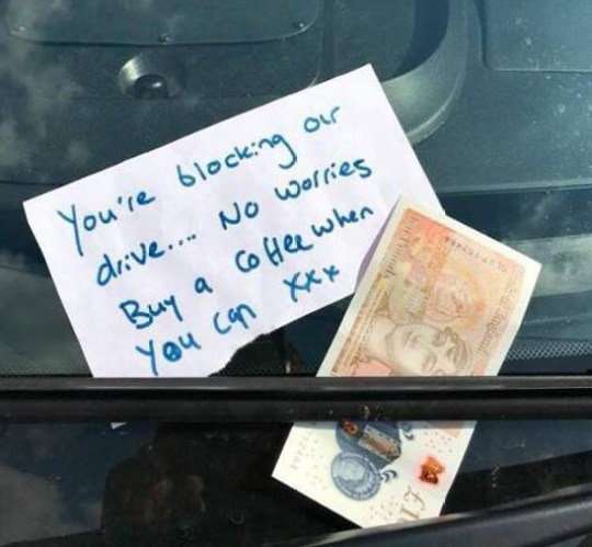 """A thank you letter saying 'You're blocking our drive...no worries.Buy a coffee when you can' and ?10 note left on an ambulance of the SE Coast Ambulance Service in Faversham, Kent. 4th September 2018. See story NNTENNER . A pleasant craze is sweeping the nation after a number of kind notes were left on ambulances attending emergencies - including one left with a tenner for coffee. After a spate of rude notes left on the emergency vehicles, moaning about paramedics blocking drives while saving lives, a number of people across the country have left positive messages for the heroes. Community first responder Carol Lewis from South East Coast Ambulance Service saw one note pinned to the window of the vehicle after responding to an emergency call. The note read: """"You're blocking our drive. No worries, buy a coffee when you can."""""""