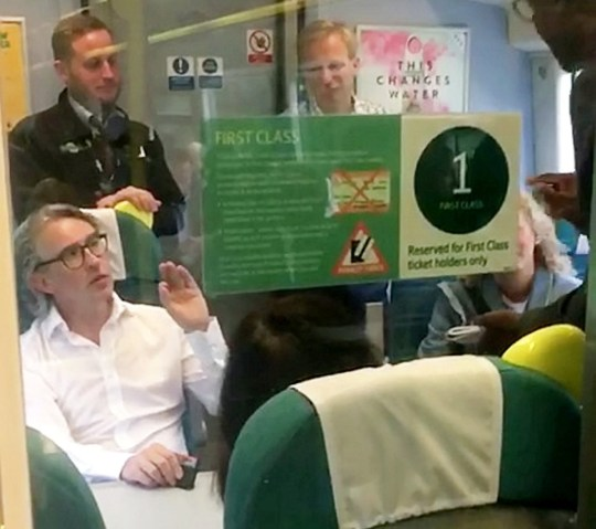 """Steve Coogan in discussion with the ticket inspector. This is the moment Steve Coogan stood up for commuters on a packed Southern Rail train - demanding passengers be allowed to travel with him in his first class carriage. See SWNS story SWCOOGAN. The Alan Partridge star, 52, was filmed exchanging words with a ticket inspector who told passengers they could not stand in the carriage without first class tickets. One commuter said: """"He was saying that it was outrageous that they should face any penalty and that they should have somewhere to sit. """"He was being very chivalrous defending the other passengers. There was one woman who was being told to leave even though she had a lot of luggage and wanted to stay with her bags. """"The train was ridiculously overcrowded with people packed into the aisles and a few passengers had wandered into the first class carriage simply to find a seat or somewhere a little bit more comfortable to stand."""" Sadly the comedian's efforts came to nothing as the commuters were ushered out of the first class carriage on the overcrowded 8.46 train from Lewes, Sussex, to London Victoria this morning."""