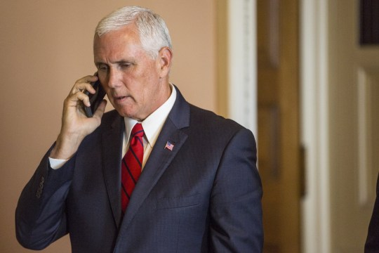 WASHINGTON, DC - SEPTEMBER 05: Vice President Mike Pence takes a phone call on Capitol Hill following a mock swear-in ceremony for U.S. Sen. John Kyl (R-AZ) on September 5, 2018 in Washington, DC. The former senator Kyl was tapped by Arizona Gov. Doug Ducey to replace the late Sen. John McCain. (Photo by Zach Gibson/Getty Images)