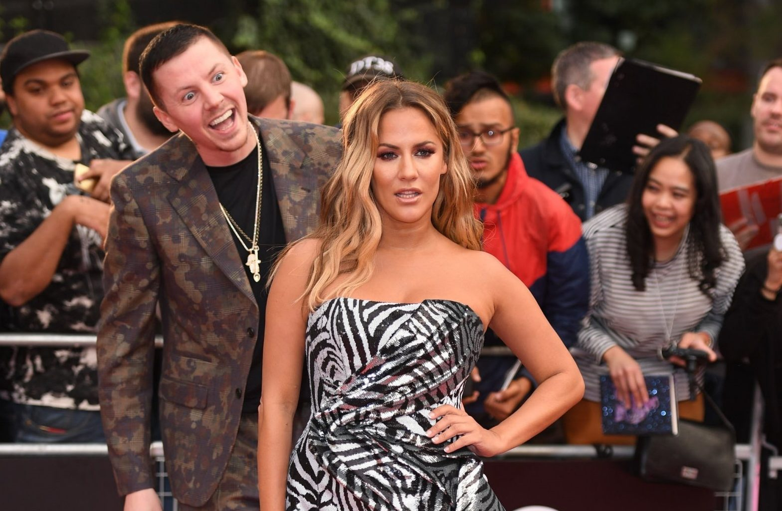 BGUK_1327042 - London, UNITED KINGDOM - The 2018 GQ Men of the Year Awards held at the Tate Modern in London Pictured: Professor Green - Stephen Paul Manderson - Caroline Flack BACKGRID UK 5 SEPTEMBER 2018 BYLINE MUST READ: TIMMSY / BACKGRID UK: +44 208 344 2007 / uksales@backgrid.com USA: +1 310 798 9111 / usasales@backgrid.com *UK Clients - Pictures Containing Children Please Pixelate Face Prior To Publication*