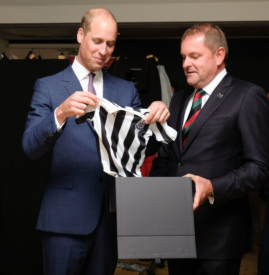 The Duke of Cambridge is presented with a Newcastle United football shirt for his son Prince George at the BALTIC Centre for Contemporary Art, Gateshead, during his visit for the Great Exhibition of the North. PRESS ASSOCIATION Photo. Picture date: Friday September 7, 2018. The exhibition is a three-month celebration of the North of England's pioneering spirit, showcasing art and culture, design and innovation from across the north. See PA story ROYAL North. Photo credit should read: Ian Forsyth/PA Wire