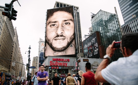 be7806cea79 epa07003822 A new Nike ad campaign billboard featuring NFL quarterback  Colin Kaepernick can be seen in