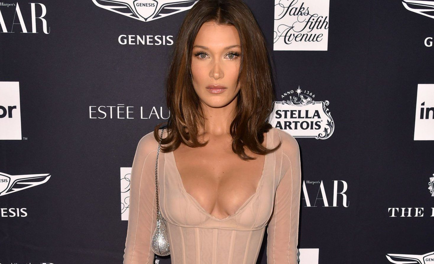 Bella Hadid hits back at hater who tells her to 'eat a cheeseburger' before Victoria's Secret fashion show