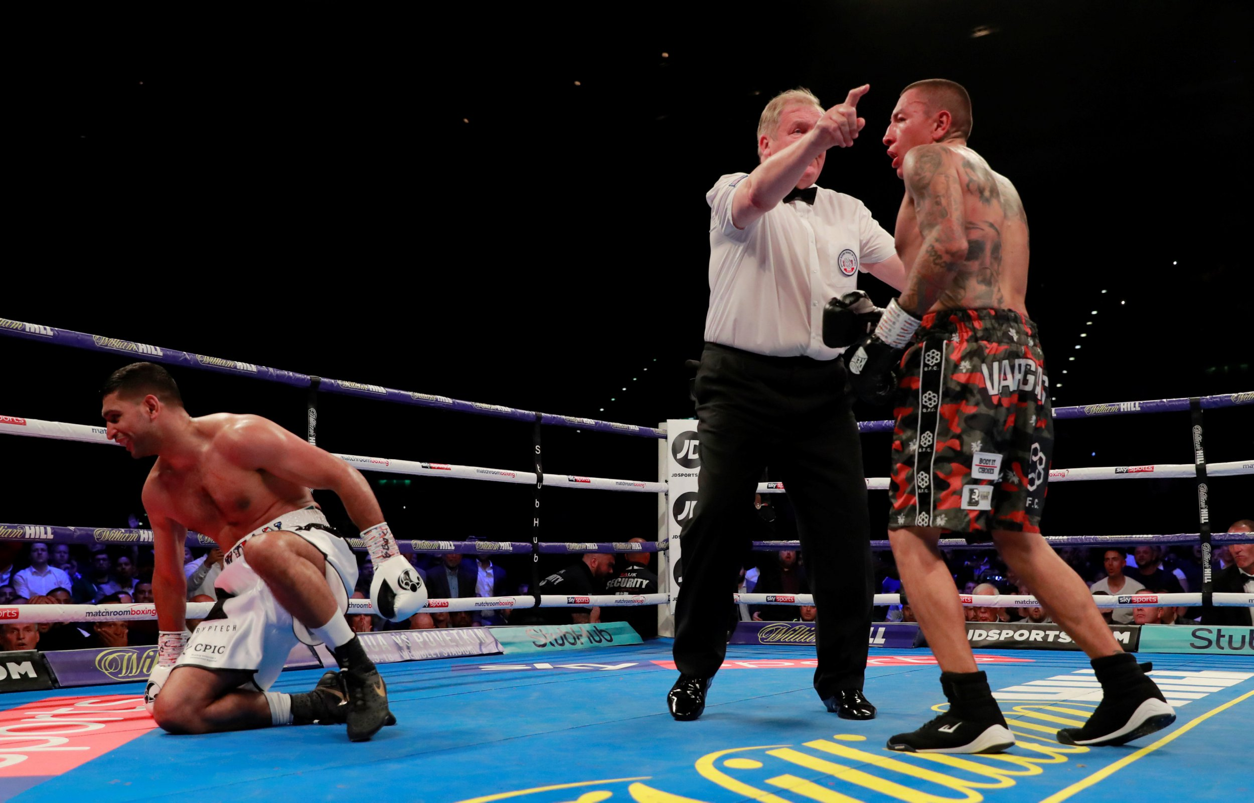 Amir Khan floored on way to points victory over Samuel Vargas