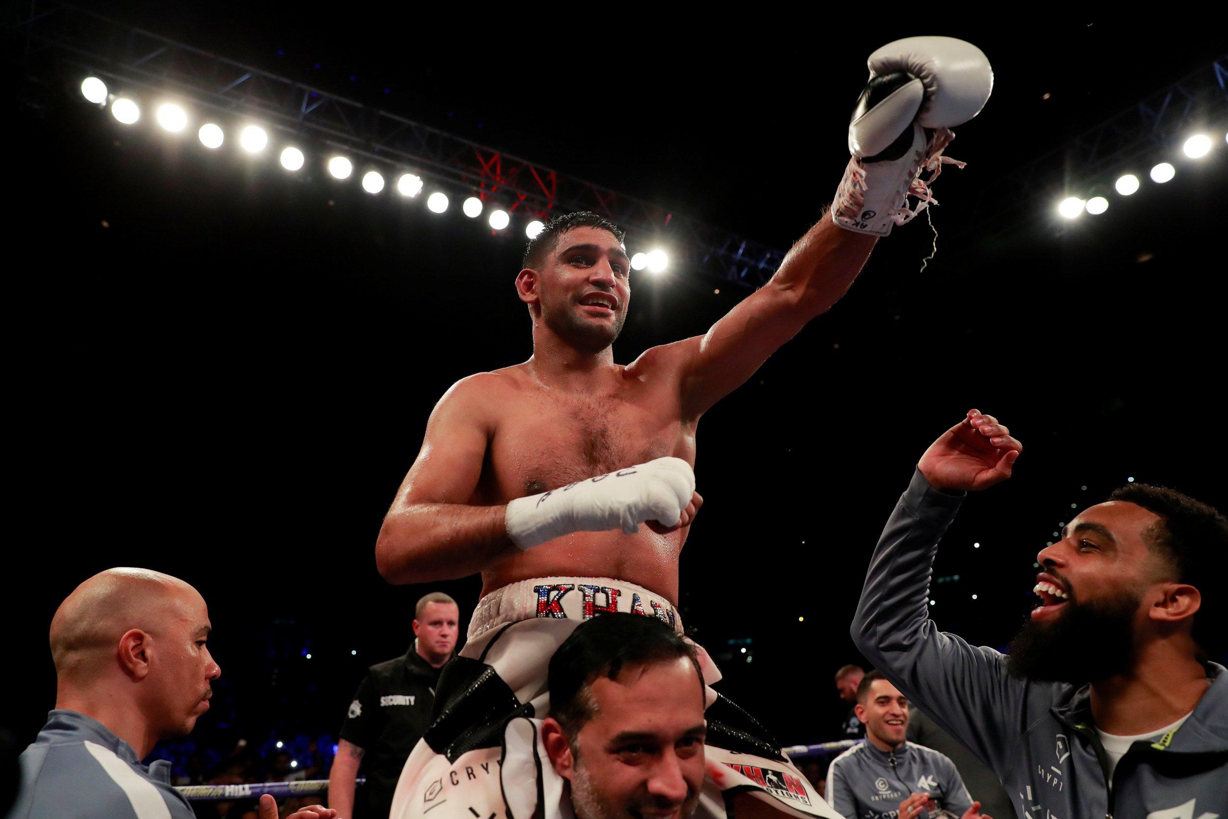 Boxing - Amir Khan v Samuel Vargas - Arena Birmingham, Birmingham, Britain - September 8, 2018 Amir Khan celebrates winning the fight Action Images via Reuters/Andrew Couldridge
