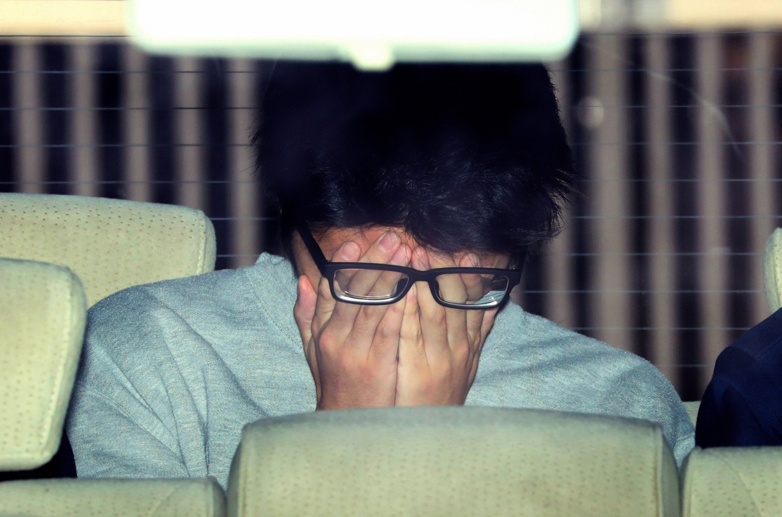 HACHIOJI, JAPAN - NOVEMBER 01: (CHINA OUT, SOUTH KOREA OUT) Suspect Takahiro Shiraishi covering his face is seen on departure at Takao Police Station as he is transferred to prosecutors on November 1, 2017 in Hachioji, Tokyo, Japan. Shiraishi, unemployed, was arrested on October 31 on suspicion of abandoning the body of one of the nine people, eight of whom were women, after police found heads, legs and arms in storage boxes and coolers in his apartment. Police have found nine human heads and about 240 pieces of bones and other body parts in his apartment. (Photo by The Asahi Shimbun via Getty Images)
