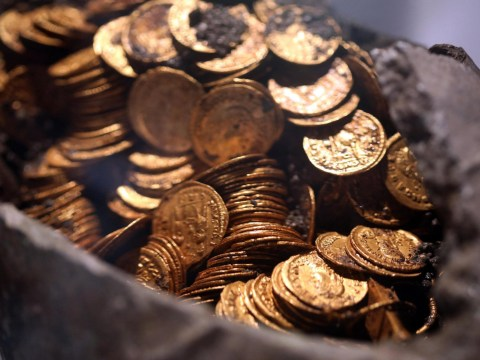 Hundreds of fifth century Roman coins found inside pot in theatre basement