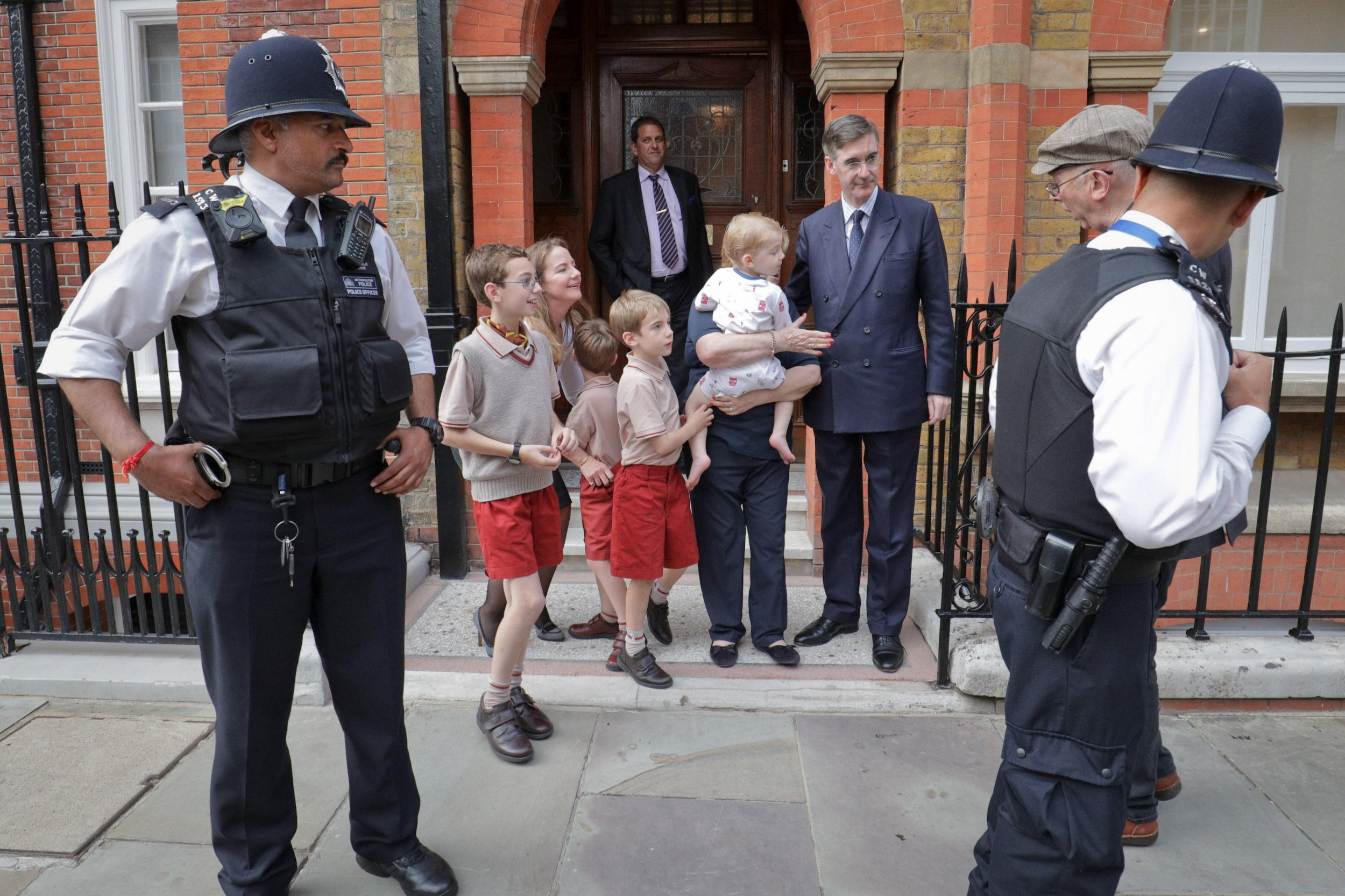 Alamy Live News. PK7FF0 London, UK. 11th September, 2018. Conservative MP Jacob Rees-Mogg and his family confront anti-capitalist protesters from Class War activist group outside his Westminster home. The protesters are claiming his long-term live-in family nanny is currently being exploited. Credit: Guy Corbishley/Alamy Live News This is an Alamy Live News image and may not be part of your current Alamy deal . If you are unsure, please contact our sales team to check.