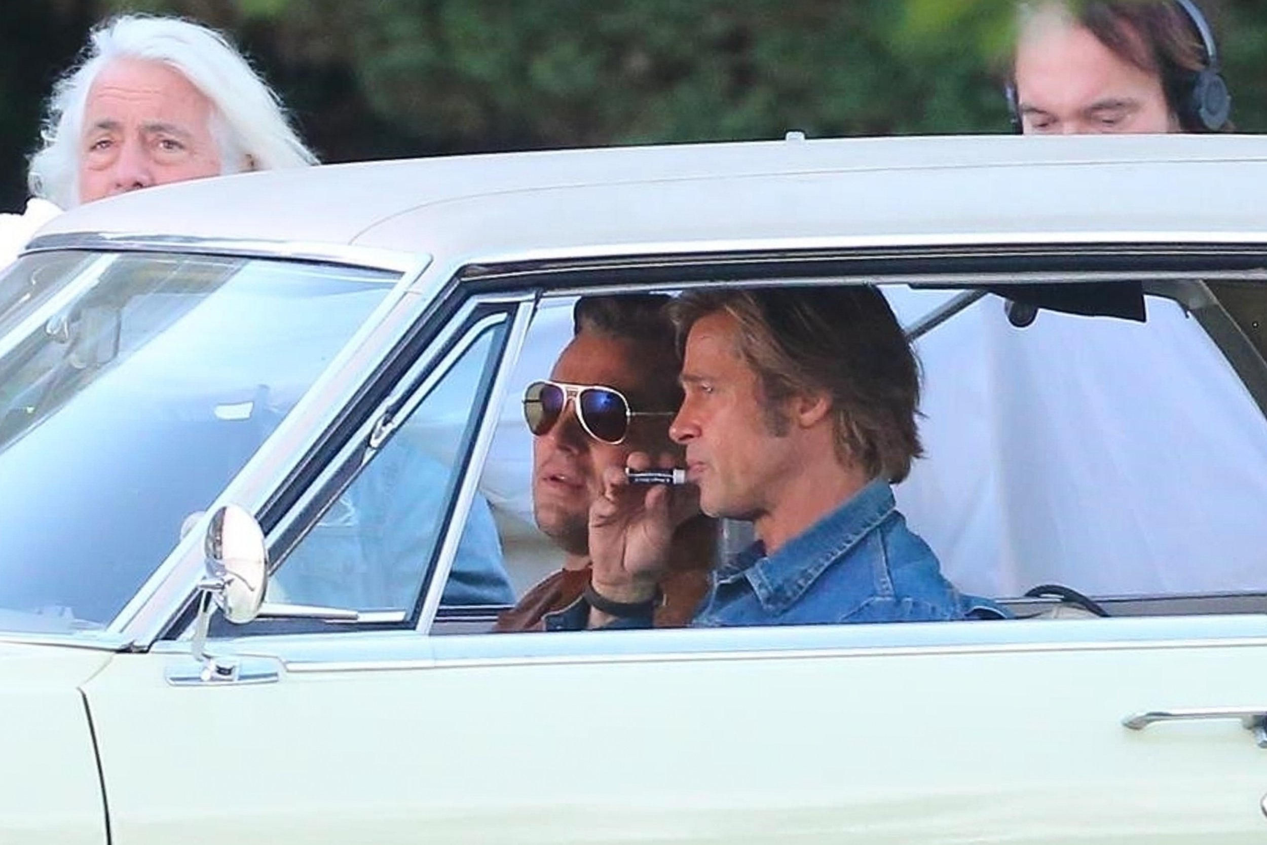 Los Angeles, CA - *EXCLUSIVE* - Brad Pitt and Leonardo DiCaprio were spotted in retro fashion on the set of their new movie, Once Upon A Time In Hollywood. In Quentin Tarantino???s crime mystery Leonardo plays TV actor Rick Dalton and Brad his stunt double Cliff Booth. The pair try to make a name for themselves in Tinseltown during the Charles Manson murders in 1969 Los Angeles. In the pictures the pair can be seen filming a car scene from the movie. Pictured: Brad Pitt, Leonardo DiCaprio, BACKGRID USA 11 SEPTEMBER 2018 USA: +1 310 798 9111 / usasales@backgrid.com UK: +44 208 344 2007 / uksales@backgrid.com *UK Clients - Pictures Containing Children Please Pixelate Face Prior To Publication*