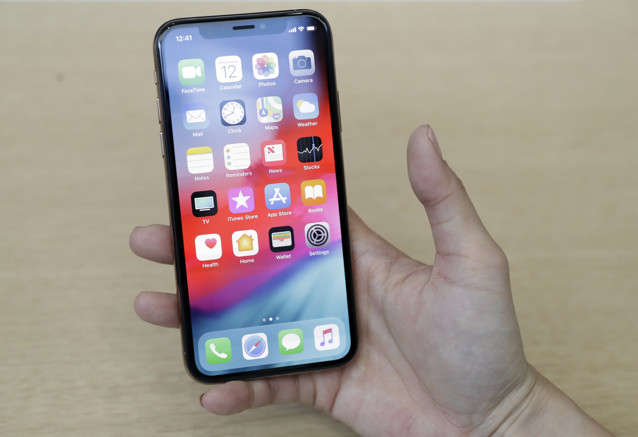 The iPhone XS is shown during an event to announce new products at Apple headquarters Wednesday, Sept. 12, 2018, in Cupertino, Calif. (AP Photo/Marcio Jose Sanchez)