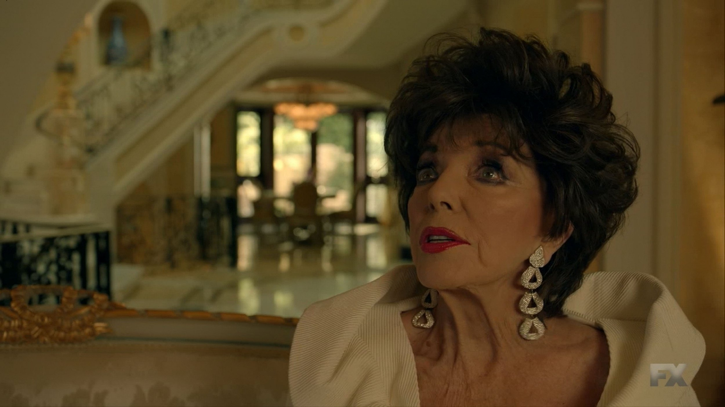 American Horror Story Apocalypse debuts with Joan Collins chowing down on human corpses as a cannibal