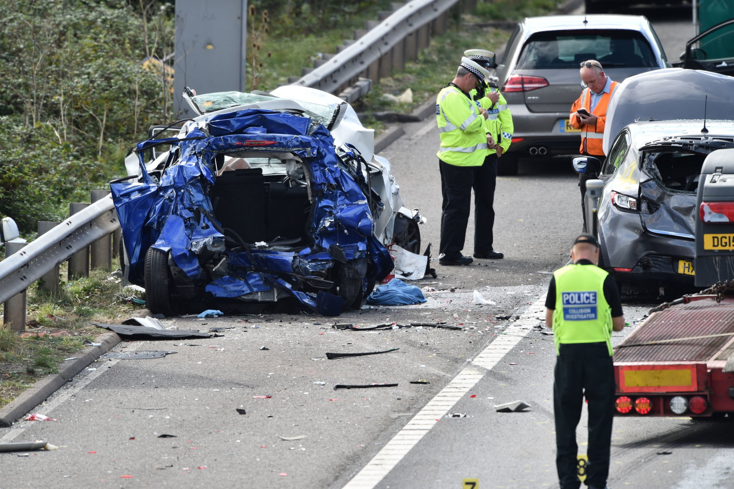 Emergency services at the scene of an accident on the M5 motorway near Taunton in Somerset. The road was closed following a collision this morning between a lorry and several cars in which two people died. PRESS ASSOCIATION Photo. Picture date: Thursday September 13, 2018. See PA story POLICE M5. Photo credit should read: Ben Birchall/PA Wire
