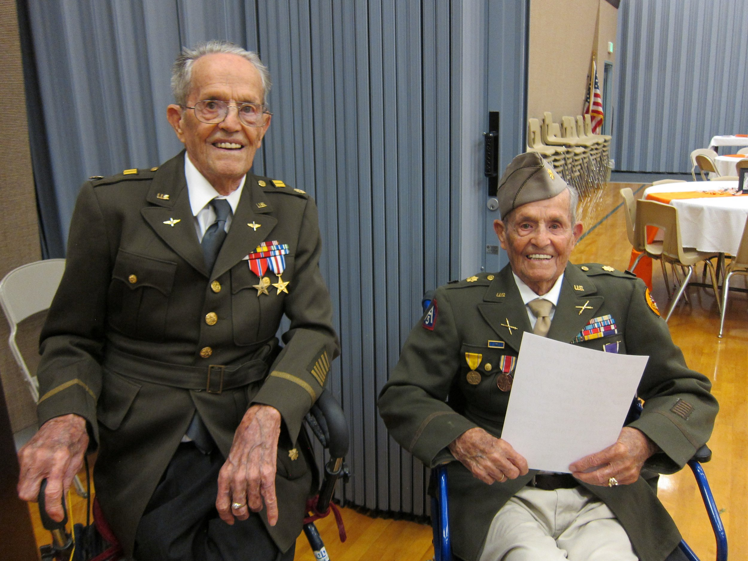 """The 105-year-old Henderson twins, Boyd and Ralph, in their military uniforms. They put their longevity down to their teetotal lifestyle.Pocatello, Idaho. September 6 2018. See story NYTWIN . Identical twin brothers have turned 100 and put the secret of their longevity down to a healthy life of abstinence - with no alcohol, tobacco or caffeine. Centenarians Boyd and Ralph Henderson are """"best friends"""" and have been inseparable since they were born in 1918.The brothers, who both married their high school sweethearts, have 14 children, 71 grandchildren and 128 great-grandchildren between them. Boyd and Ralph, who were born in Arimo, Idaho, USA, fought together during World War II in far flung battlefields of North Africa and Europe."""