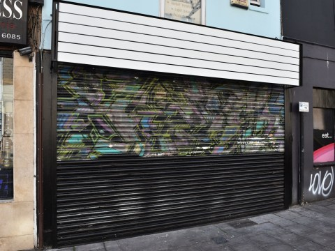 Early Banksy mural accidentally painted over as shop gets new owners