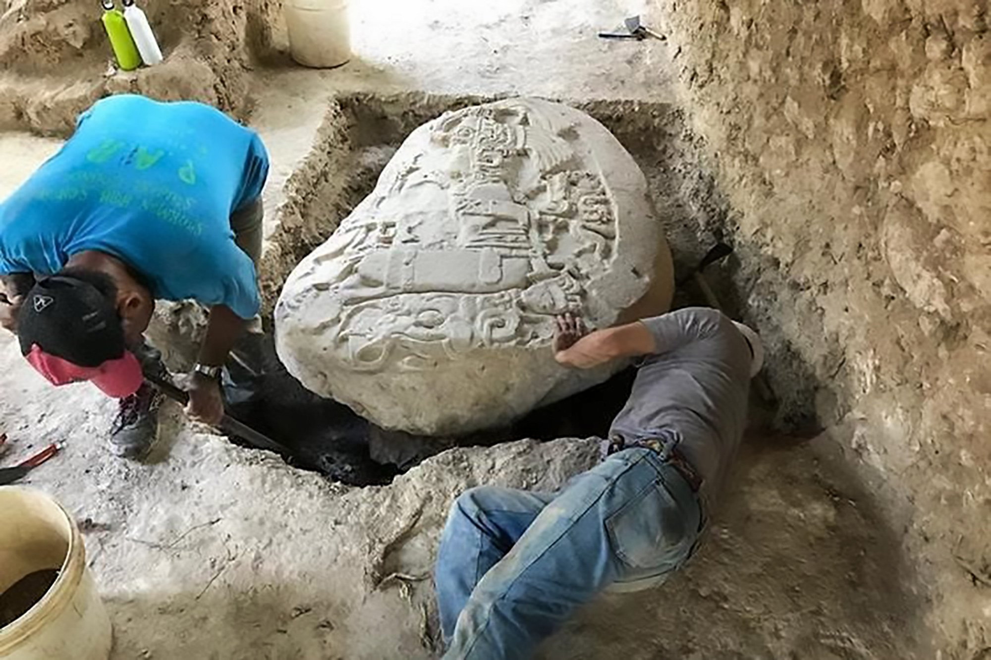 """Pic Shows: The Mayan altar in the archaeological site; Archaeologists have uncovered a 1,500-year-old altar used by priests from the Mayan Snake Kingdom that they say sheds light on a period uncannily like Game of Thrones. The Snake Kings' sudden rise to power and defeat of their enemies like the rival city of Tikal around 6AD is now believed to have been based on elaborate alliances with smaller cities. The altar was sculpted in stone and weighs almost a tonne. It was found in the archaeological site of La Corona, in the department of Peten, in Guatemala, near the border with Mexico and Belize. Archaeologists have explained that the altar belongs to what is known as the Classic Mayan Period, considered to be from 250 AD to 900 AD, and specifically to the beginnings of the expansion of the Kaanul dynasty, also known as the """"Kan"""" Kingdom, or Snake Kingdom. The complex political and military intrigues of this dynasty are what have led archaeologists to make comparisons with Game of Thrones. Thomas Barrientos, Co-Director of the project, explained that the altar was found in a temple. It shows King Chak Took Ich???aak, who was the Governor of La Corona, """"sitting and holding a sceptre on which there are representations of the two Gods of the city."""" The piece is around 1.46 metres (4.7 feet) long and 1.20 metres (3.9 feet) wide and has an inscription in Mayan hieroglyphics showing the date, which is 12th May 544 AD in the Gregorian Calendar. It is carved with elaborate representations of scenes from the period. Barrientos explained that findings like the altar reveal the power of the lords of Kaanul and the Snake Kingdom which they created in La Corona as a political movement to help them overcome their main rivals from Tikal in 562 AD. The Snake Kings went on to rule over the Mayan lowlands, in south-eastern Meso-America, for almost two centuries. The Snake Kings' sudden rise to power through its Game of Thrones-style intrigues with smaller kingdoms left their"""