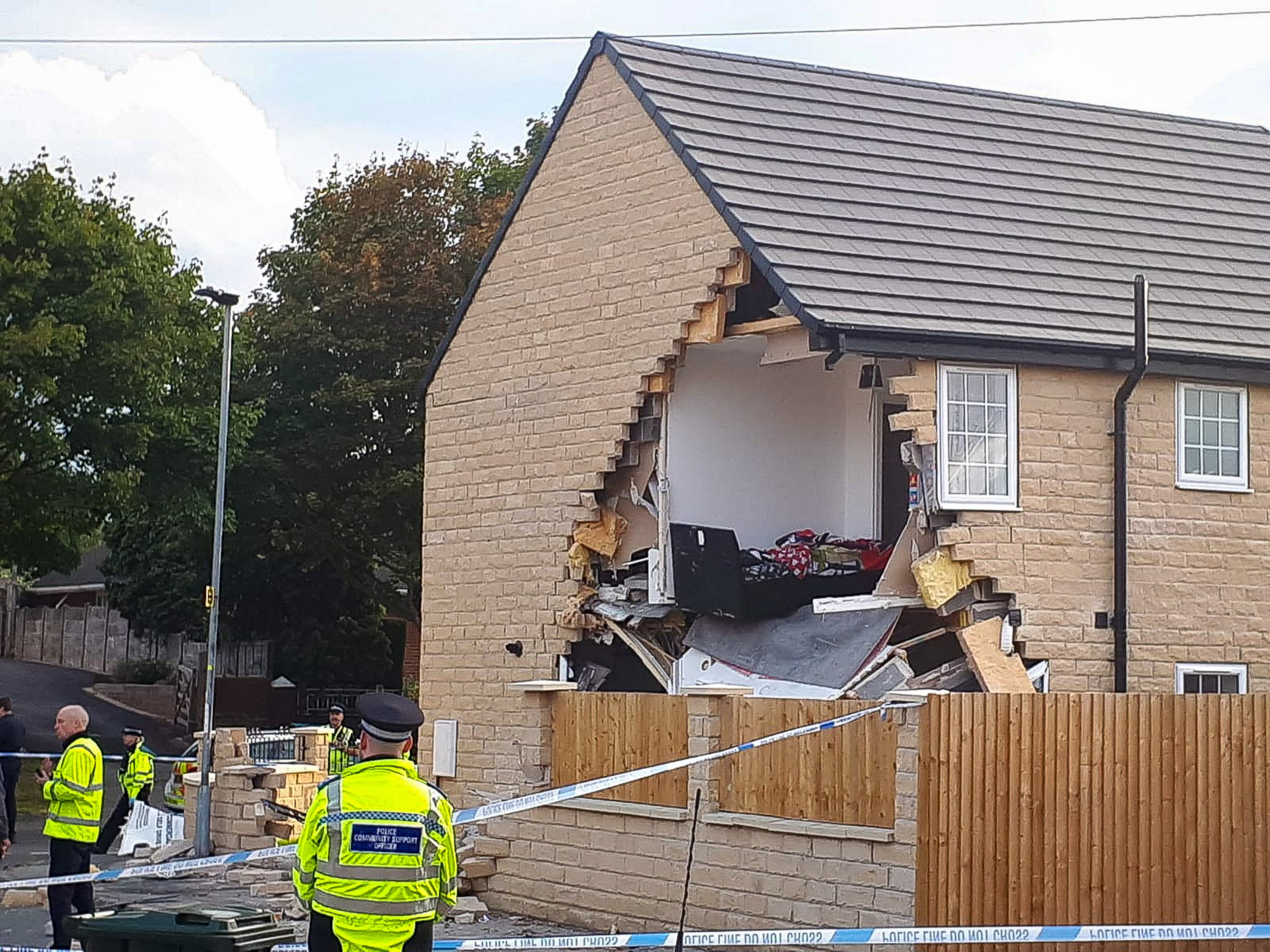 MERCURY PRESS 14/09/18 Barnsley, UK. (PICTURED: Three people were injured when a lorry crashed into the side of a house in Barnsley. Police were called to Park View, in Brierley following reports of an incident involving an HGV. South Yorkshire Fire and Rescue said three fire engines, including one from West Yorkshire, were sent to the scene.) Photo Credit CAG Photography/Mercury Press
