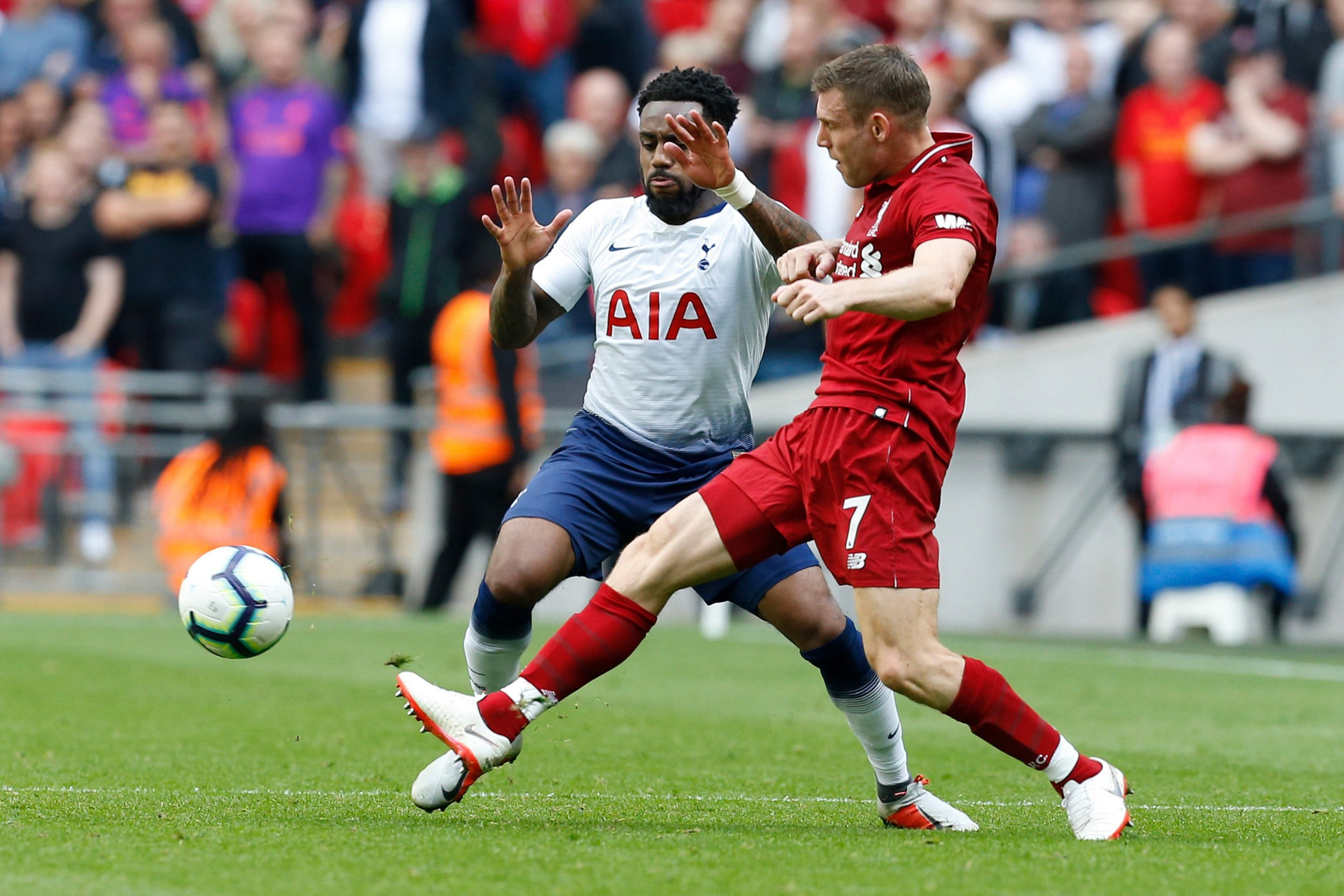 Tottenham Hotspur's English defender Danny Rose (L) vies with Liverpool's English midfielder James Milner during the English Premier League football match between Tottenham Hotspur and Liverpool at Wembley Stadium in London, on September 15, 2018. (Photo by Ian KINGTON / IKIMAGES / AFP) / RESTRICTED TO EDITORIAL USE. No use with unauthorized audio, video, data, fixture lists, club/league logos or 'live' services. Online in-match use limited to 45 images, no video emulation. No use in betting, games or single club/league/player publications.IAN KINGTON/AFP/Getty Images