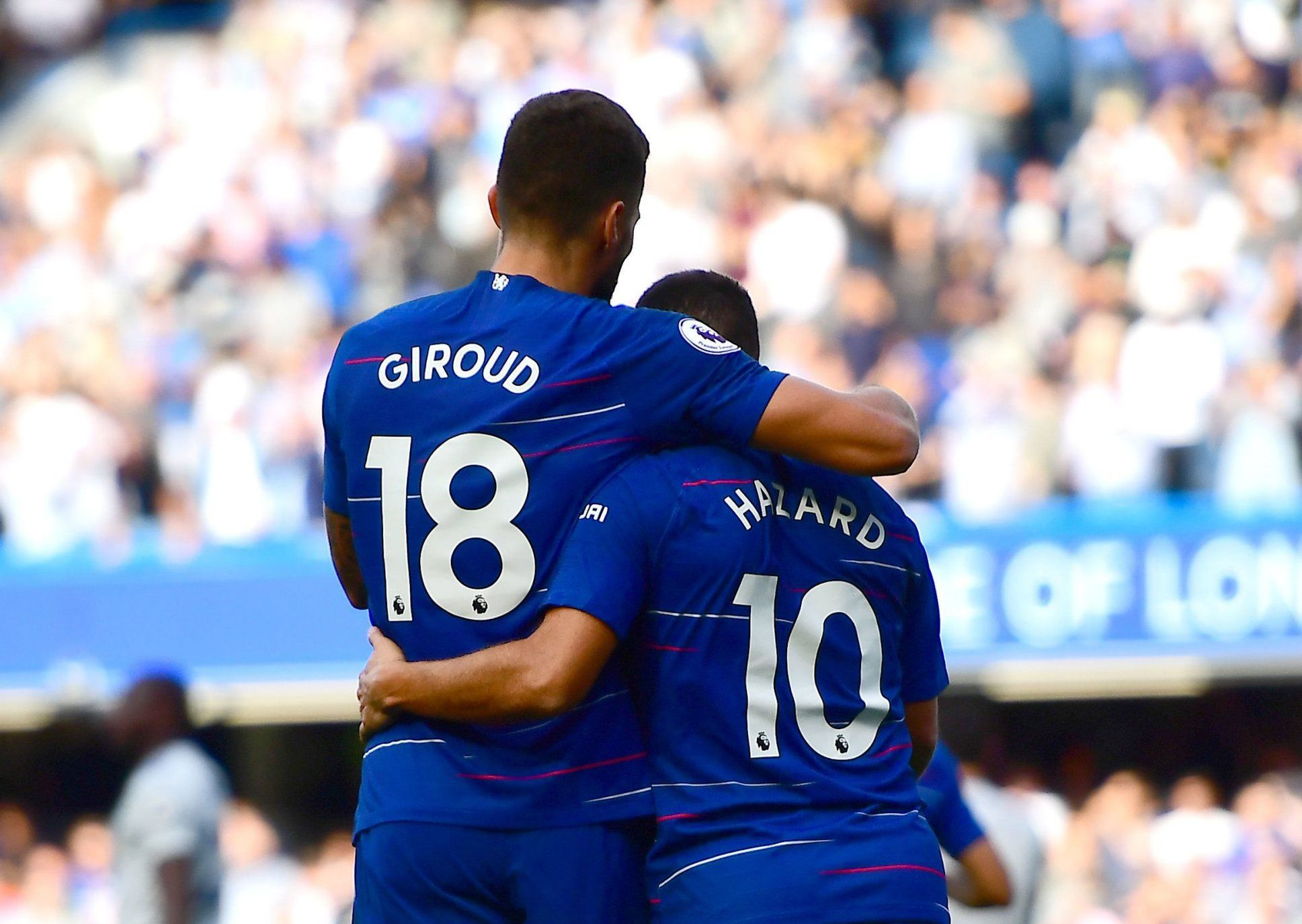 "Chelsea's Eden Hazard celebrates scoring his side's first goal of the game with Olivier Giroud (left) during the Premier League match at Stamford Bridge, London. PRESS ASSOCIATION Photo. Picture date: Saturday September 15, 2018. See PA story SOCCER Chelsea. Photo credit should read: Victoria Jones/PA Wire. RESTRICTIONS: EDITORIAL USE ONLY No use with unauthorised audio, video, data, fixture lists, club/league logos or ""live"" services. Online in-match use limited to 120 images, no video emulation. No use in betting, games or single club/league/player publications."