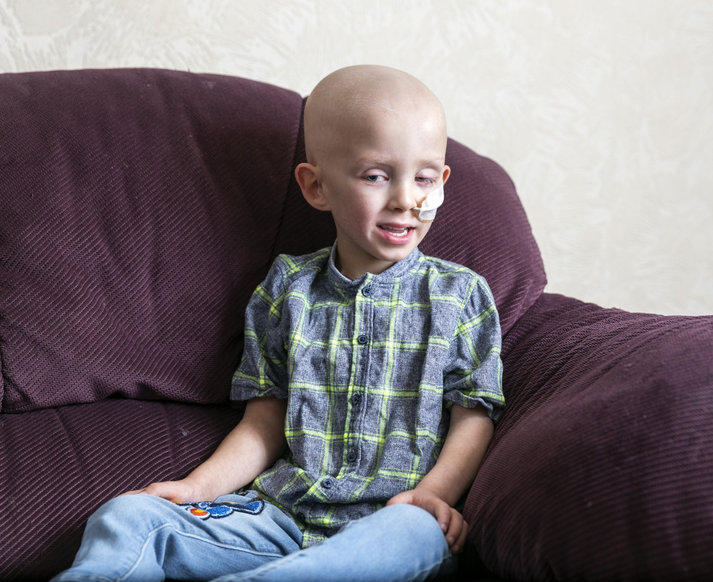 Lucas Hellowell, 5, pictured at his house in Halifax, West Yorkshire. See Ross Parry copy RPYCANCER: The parents of Britain's youngest testicular cancer fighter discovered his tumour the size of a GOLF BALL as they helped him to get dressed. Brave five-year-old Lucas Hellowell has successfully undergone an operation to remove the huge tumour and is courageously undergoing chemotherapy. His parents Mel Speight, 25 and Jonathan Hellowell, 28, discovered the tumour on July 6 this year while dressing him as he was off school due to having bellyache.