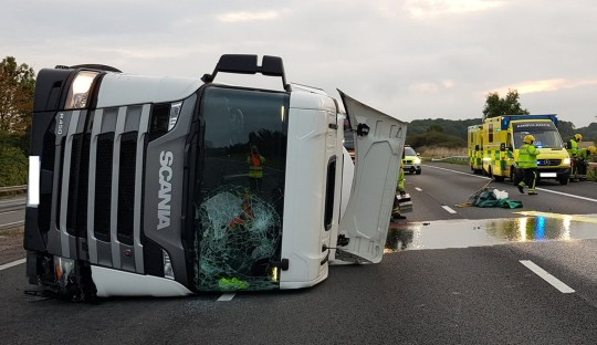 INS News Agency Ltd. 16/09/2018 *************** Picture by INS Picture Desk *************** A motorway was today/yesterday (Sun) shut by MILK after a dairy tanker crashed and spilled its contents all over the carriageway. Several miles of traffic were held up following the incident which saw thousands of litres of milk spread over the tarmac, as well as diesel fuel from the lorry's tank. It appeared that the truck smashed into the barrier on the side of the road while travelling westbound down the motorway. See copy INS
