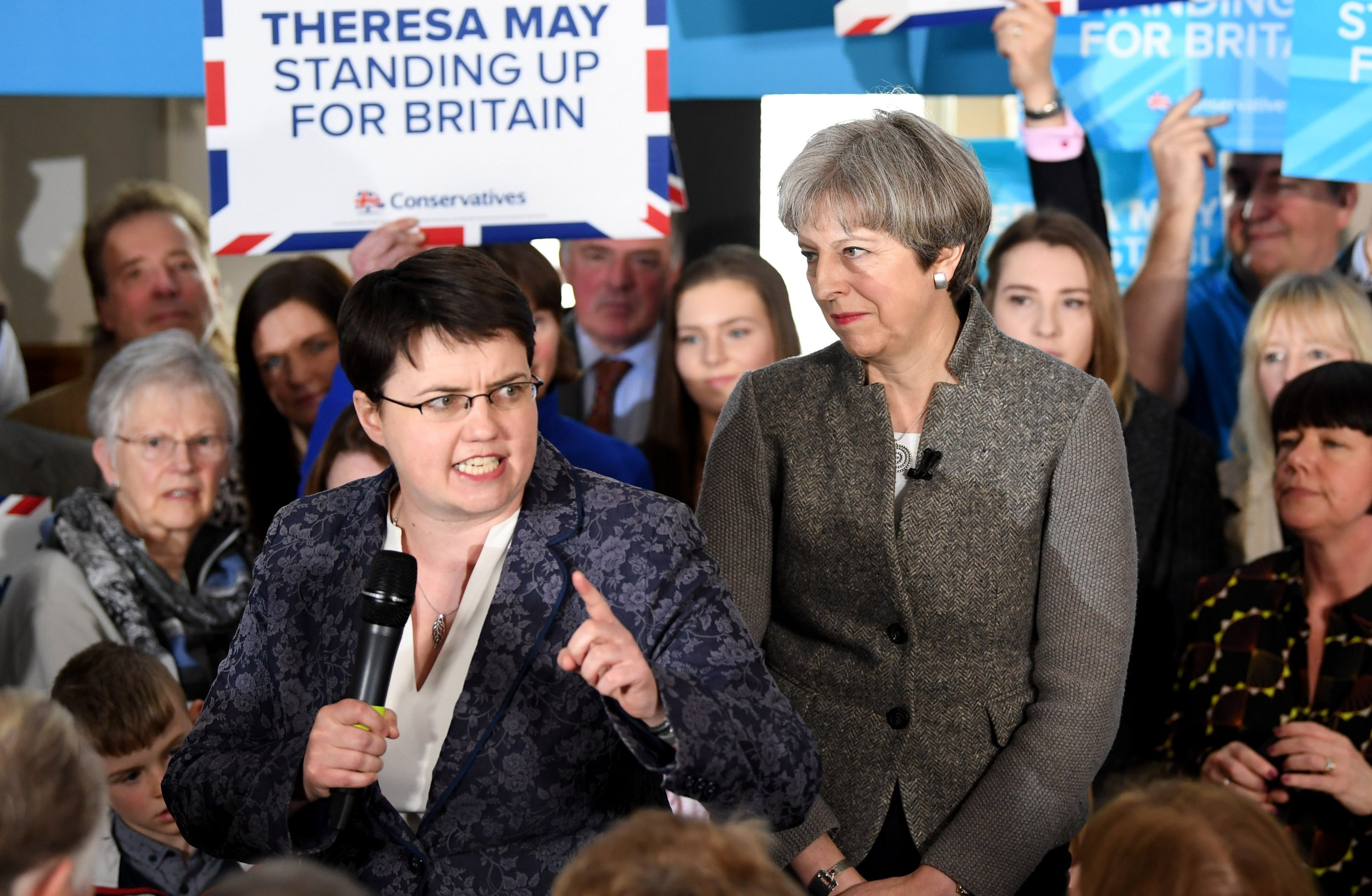 BANCHORY, SCOTLAND - APRIL 29: British Prime Minister Theresa May looks into the crowd as Scottish Conservative Leader Ruth Davidson (L) speaks at an election campaign rally on April 29, 2017 in Banchory, Scotland. The Prime Minister is campaigning in Scotland with the message that a vote for the Conservatives would strengthen the economy and the UK's hand in Brexit negotiations. The UK goes to the polls on June 8. (Photo by Jeff J Mitchell/Getty Images)