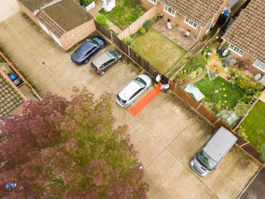 Neighbours' ten year dispute over 30-inch 'parking space