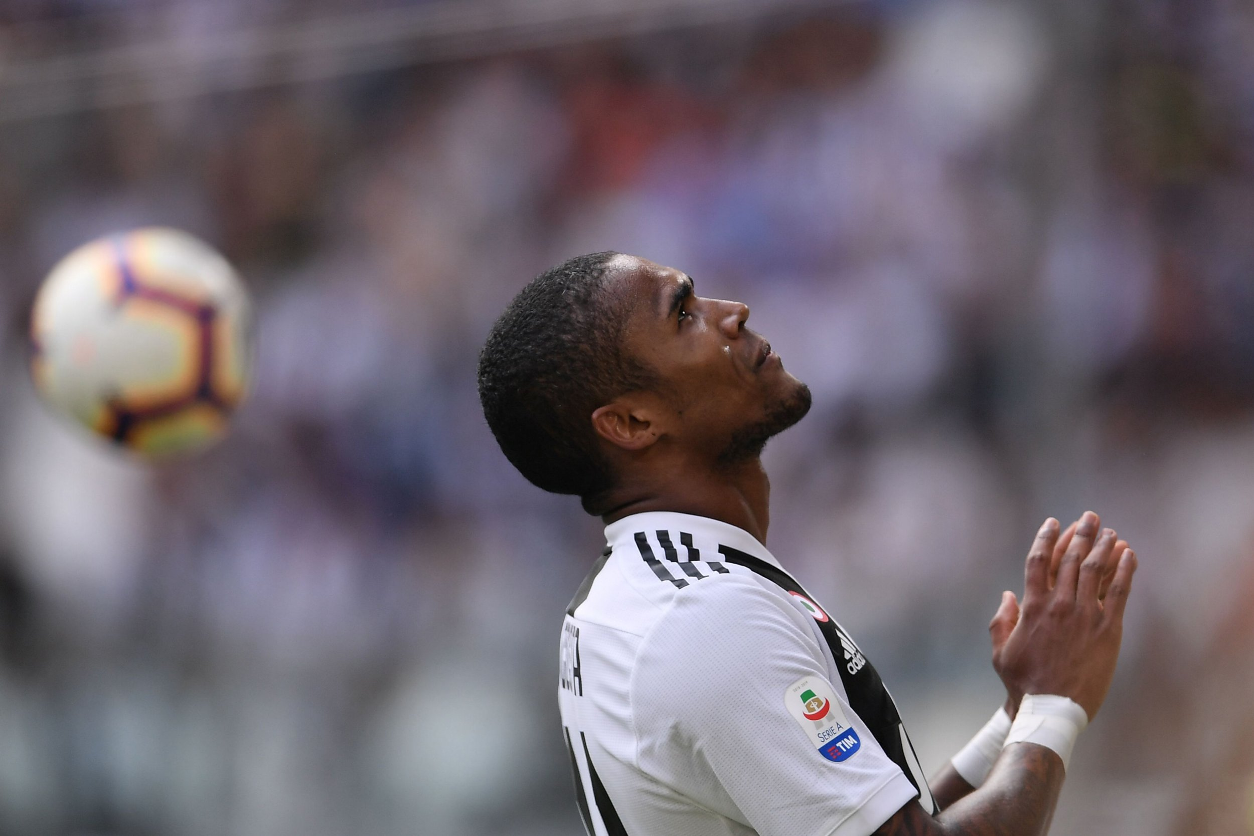 Juventus' Brazilian forward Douglas Costa reacts during the Italian Serie A football match Juventus vs Sassuolo on September 16, 2018 at the Juventus stadium in Turin. (Photo by Marco BERTORELLO / AFP)MARCO BERTORELLO/AFP/Getty Images