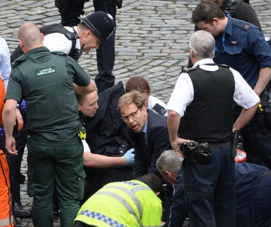 File photo dated 22/3/2017 of Conservative MP Tobias Ellwood (centre) helps emergency services attend to a police officer outside the Palace of Westminster, London, after PC Keith Palmer was stabbed and his apparent attacker shot by officers in a major security incident at the Houses of Parliament. The former soldier gave evidence on Monday in the inquest at the Old Bailey into the deaths of the victims of the terrorist attack. PRESS ASSOCIATION Photo. Issue date: Monday September 17, 2018. See PA story INQUEST Westminster. Photo credit should read: Stefan Rousseau/PA Wire