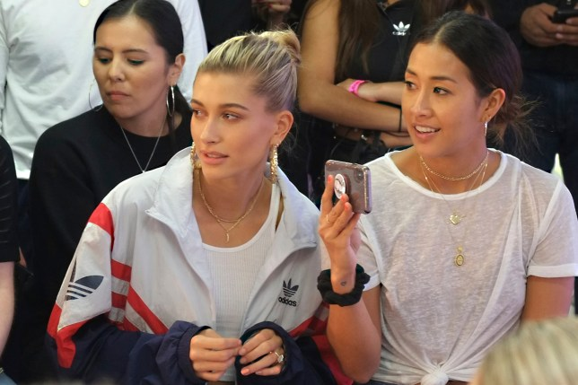 Designer Hailey Baldwin, centre left, watches her Adidas Spring/Summer 2019 runway show at London Fashion Week in London, Monday, Sept. 17, 2018. (Photo by Dejan Jankovic/Invision/AP)