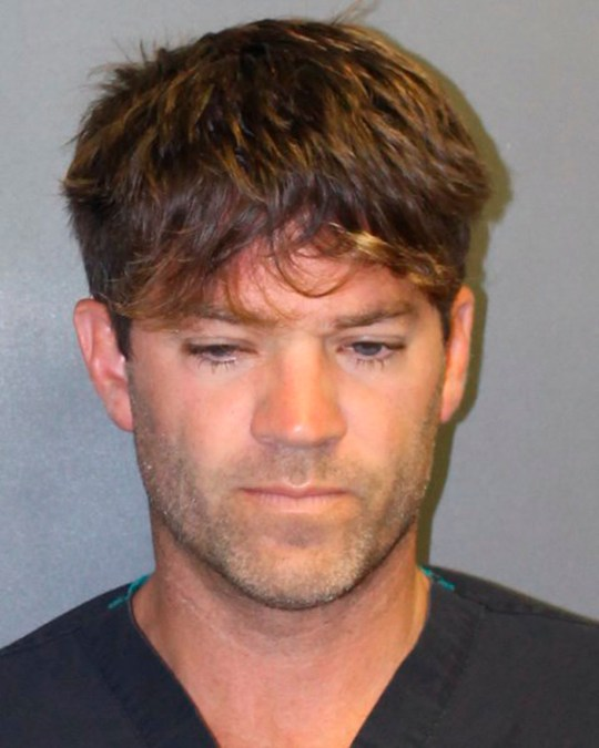 This undated booking photo provided by the Newport Beach, Calif., Police Department shows Grant W. Robicheaux, 38, a California doctor who appeared in a reality TV dating show. He and a woman co-defendant, Cerissa Laura Riley, 31, have been charged with drugging and sexually assaulting two women, and authorities suspect there may be many more victims. Orange County District Attorney Tony Rackauckas announced charges Tuesday, Sept. 18, 2018 against Robicheaux of Newport Beach and Riley of Brea. (Newport Beach Police Department via AP)
