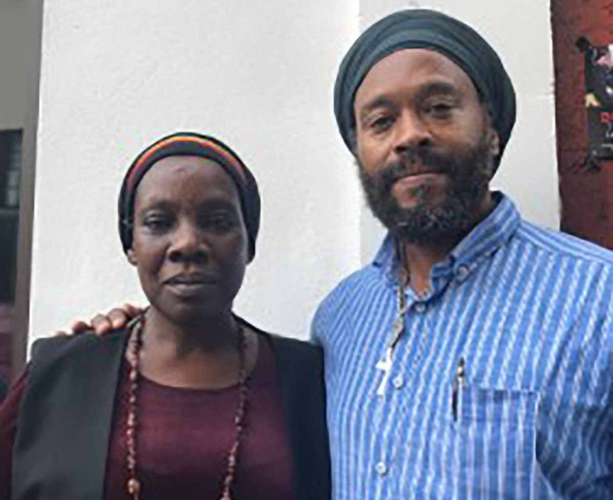 - Picture of London bus driver Marcia Carty, 54 and her brother (unarmed)TRIANGLE NEWS 0203 176 5581 // contact@trianglenews.co.ukBy Matt LennonA RASTAFARIAN bus driver was threatened with the sack for wearing what she claims is a religious headscarf at work.London bus driver Marcia Carty, 54, has worn her sacred red, gold and green headscarf for more than a decade while ferrying passengers around the capital.But her employer - bus operator Metroline Travel - has now banned her from wearing the colourful head covering, which she says she must wear to observe her faith.*Full story filed via the wires*