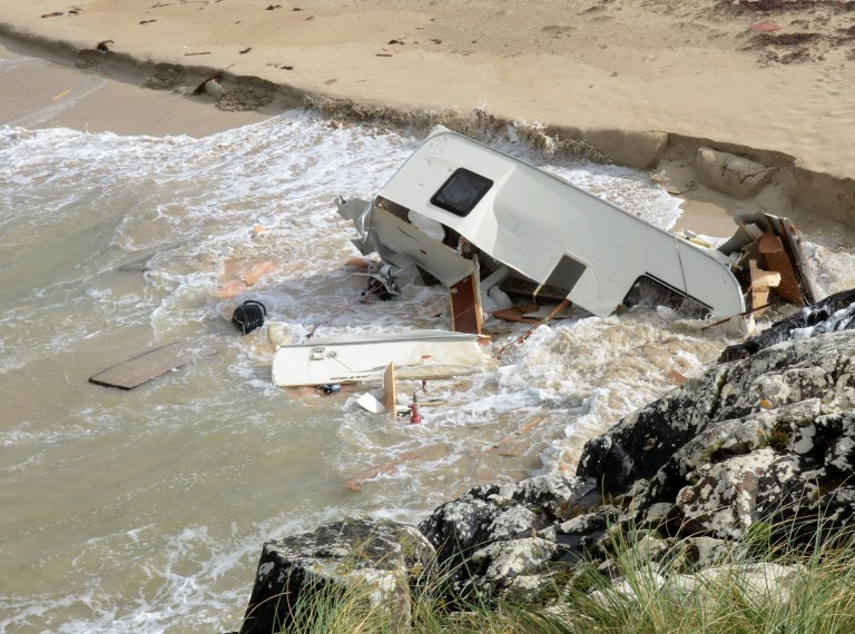 Woman dies inside caravan blown off cliff by Storm Ali