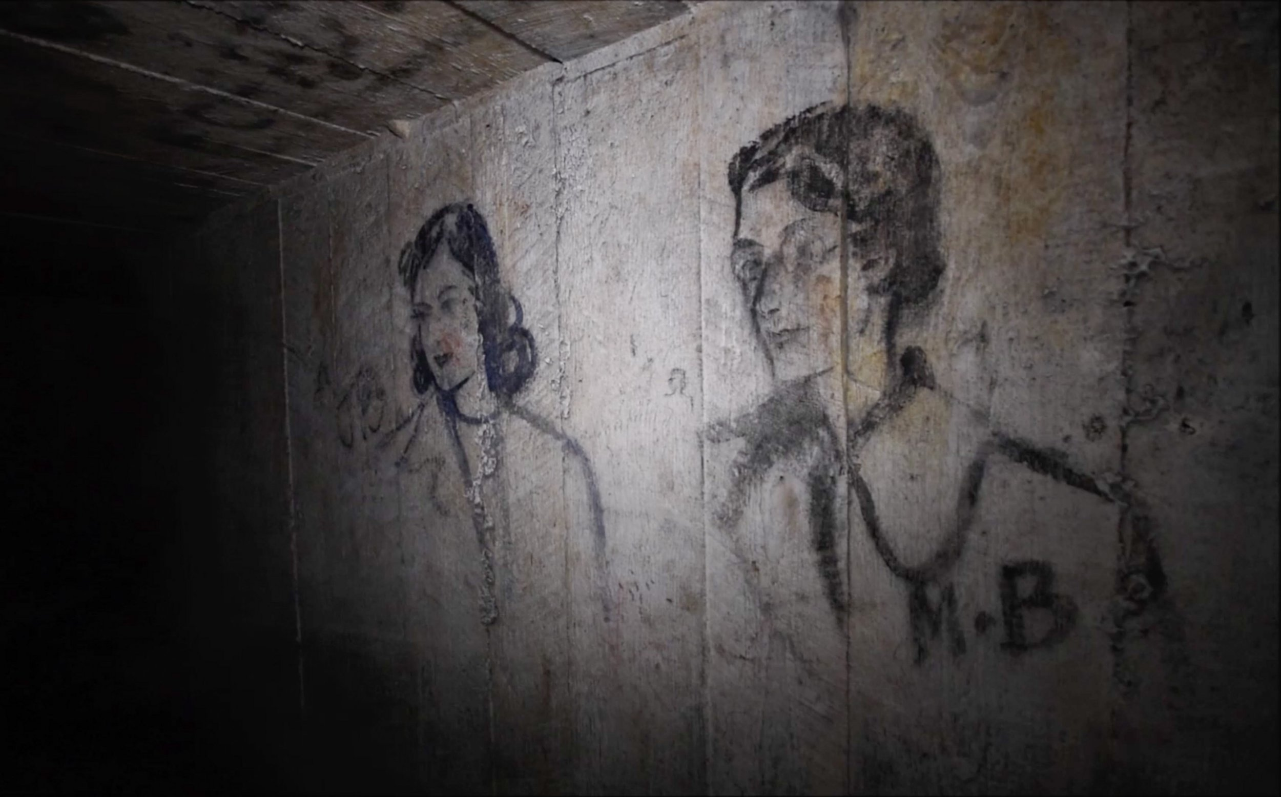 MERCURY PRESS. 20/09/18. Pictured: Coal drawings on the walls onside the WWII bunker. An urban explorer has revealed striking footage of portraits, he believes date back to WWII, sketched over the walls of a secret wartime bunker. Chris Halliwell, 31, had heard whispers of the drawings and decided he needed to see them for himself, dedicating three days of research to finding the entrance to the bomb shelter. Despite all his research, the dad of four was stunned as he wandered through a mile of haunting tunnels to find the walls were plastered with coal portraits of characters from an era long past. SEE MERCURY COPY. Photo Credit: CJ Urbex/Mercury Press
