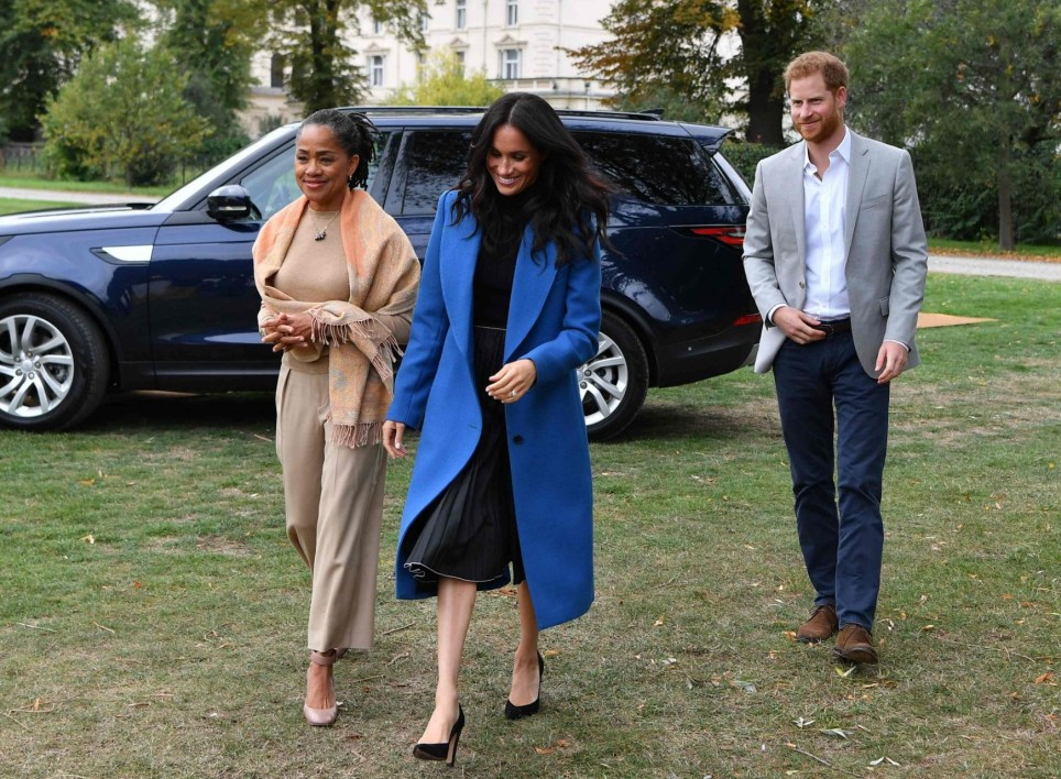 Meghan, Duchess of Sussex (C) arrives with her mother, Doria Ragland (L) and Britain's Prince Harry, Duke of Sussex to host an event to mark the launch of a cookbook with recipes from a group of women affected by the Grenfell Tower fire at Kensington Palace in London on September 20, 2018. (Photo by Ben STANSALL / POOL / AFP)BEN STANSALL/AFP/Getty Images