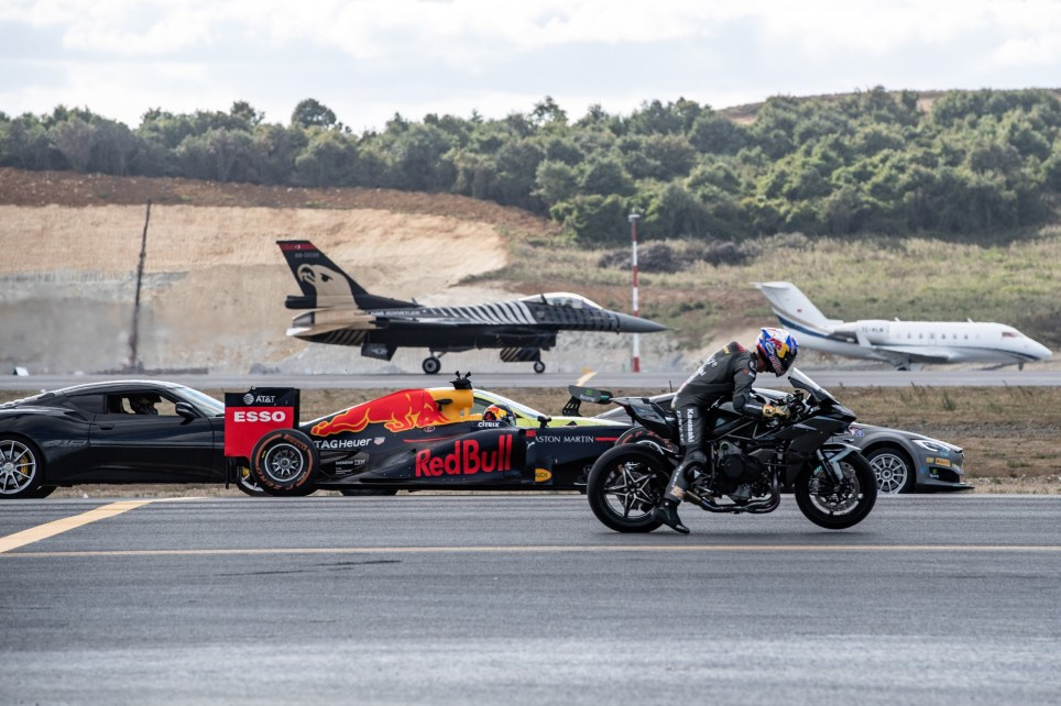 epa07034914 A handout photo made available by Teknofest show Kenan Sofuoglu of Turkey rides his Kawasaki H2R ahead of Tesla PL100DL pilot Emma Kimilainen of Finland, Aston Martin the New Vantage pilot Yagiz Avci of Turkey, Red Bull Racing Formula 1 pilot Jake Dennis of Great Britain, Lotus Evora GT 430 pilot Toprak Razgatlioglu of Turkey, F16 Fighter Jet and Challenger 605 Private Jet during the Ultimate Race during the Teknofest festival at Istanbul's new airport in Istanbul, Turkey, 20 September 2018. The Teknofest aviation, space and technology events will take place at the Istanbul's new international airport before its opening in October. EPA/JOERG MITTER / TEKNOFEST / HANDOUT HANDOUT EDITORIAL USE ONLY/NO SALES